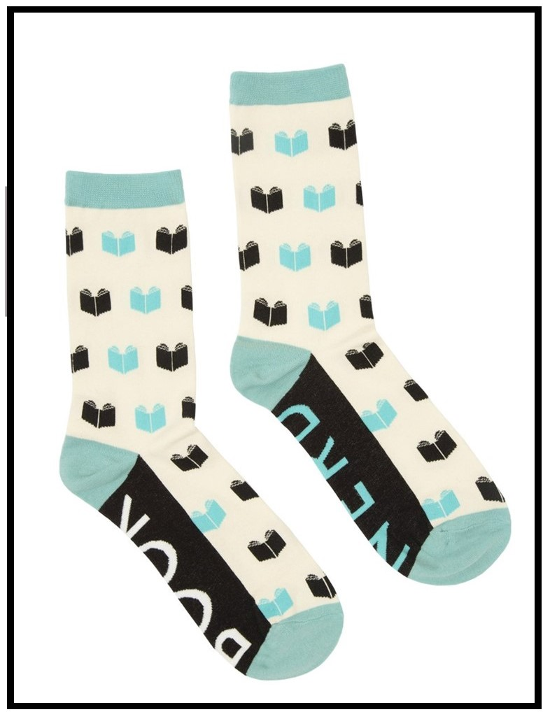 Image of socks with books and the words book nerd