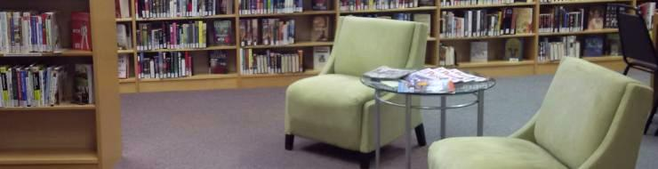 Two empty chairs and a side table